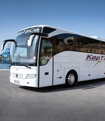 koptaco malta airport transfer point to point bus van minibus company transport service